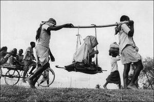 two-men-carrying-woman-1947